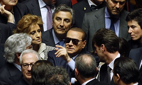Italy's former Prime Minister Silvio Berlusconi pulls ministers out of ruling coalition