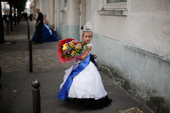 Weekend in pictures: Paris, France: Lou Hamrani, 6, walks in the street after attending the Mini