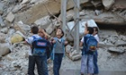 Children walk through damaged streets as they go to school in the Duma neighbourhood in Damascus on 29 September 2013.
