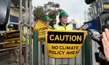 Climate change protesters wait for Tony Abbott at Penrice Soda Holdings in Adelaide.