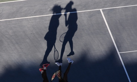 Shadows of Serena Williams (L) and Venus WIlliams during their match in the Women's Doubles at the US Open, Flushing, New York.