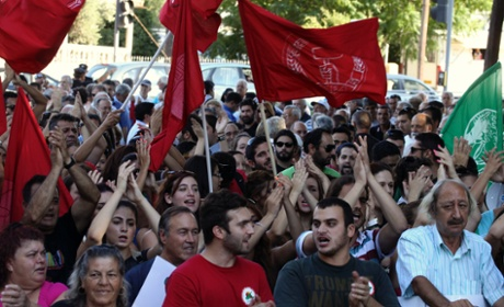 Cypriots protest against austerity measures in a demonstration outside the parliament in Nicosia, September 5, 2013.