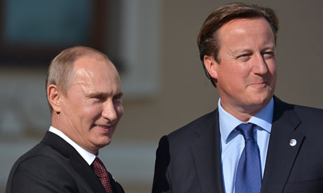 Vladimir Putin (left) meets David Cameron at the G20 summit in Saint Petersburg