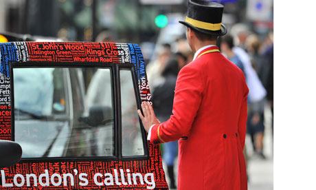 A doorman closes a taxi door outside a hotel