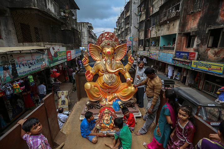 Hindu God Ganesha : A golden statue of the Lord Ganesha