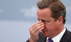 David Cameron holds his nose