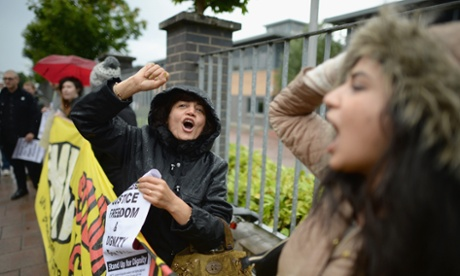 Protestors gather outside the UK Border Agency to demonstrate against the home office's Go Home campaign in Glasgow, Scotland. The poster campaign began on the 29th of July and advises people not eligible to stay in the UK that they can be given assistance to go home. Charity groups have condemned the campaign as racist.
