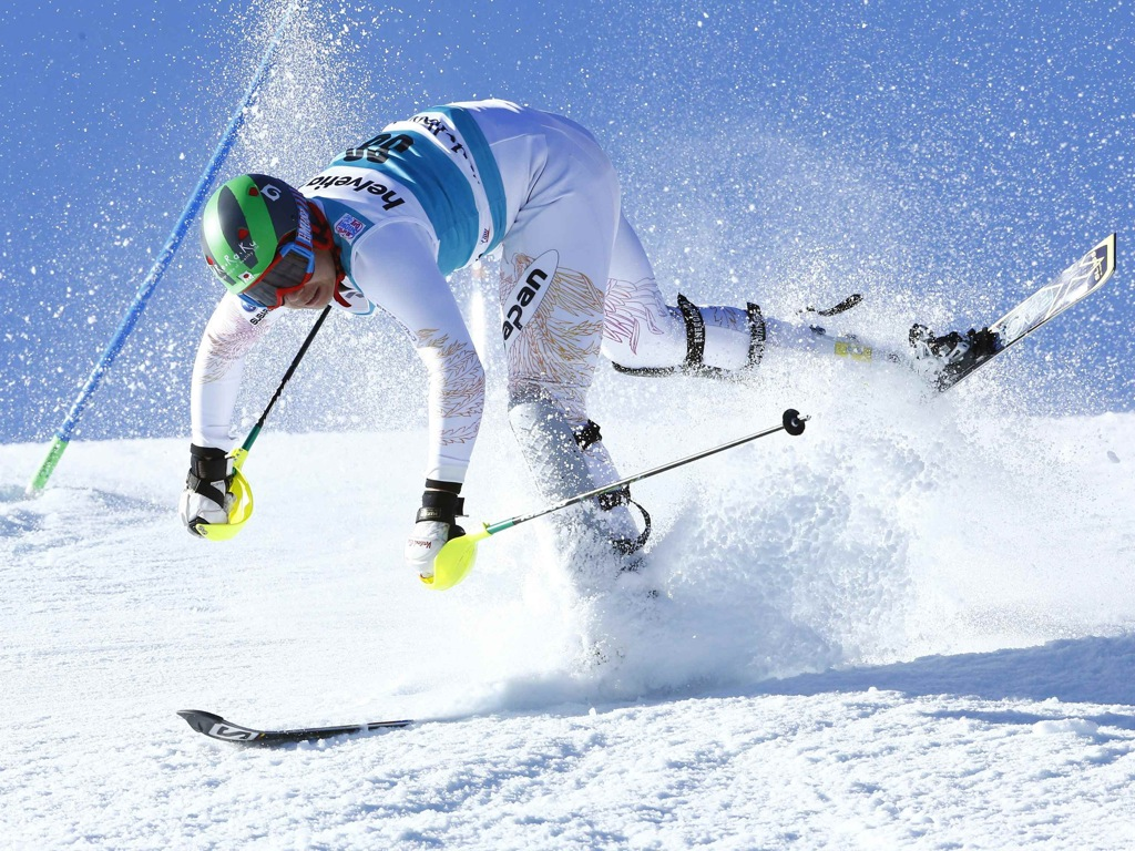 Sasaki of Japan falls during the first run of the men's World Cup Slalom ski race in Adelboden