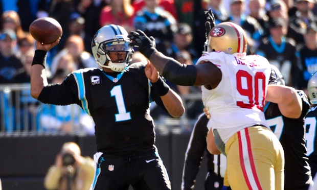 Carolina Panthers quarterback Cam Newton under pressure from San Francisco 49ers nose tackle Glenn Dorsey at Bank of America Stadium