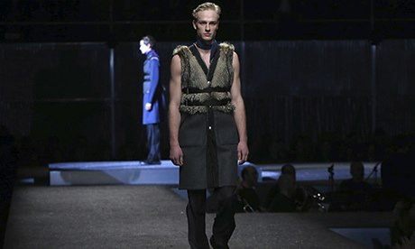 Prada makes fur harnesses and thin scarves masculine