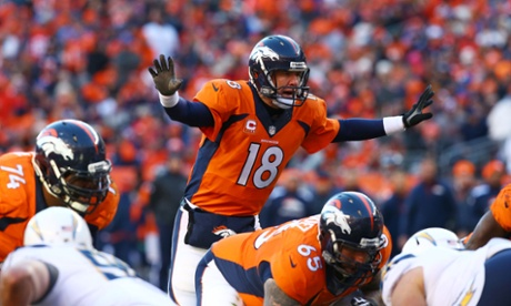 Peyton Manning of the Denver Broncos calls a play  against the San Diego Chargers during the AFC Divisional Playoff