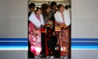 Women in kimonos ride a train after a ceremony celebrating Coming of Age Day at an amusement park in Tokyo, Japan.