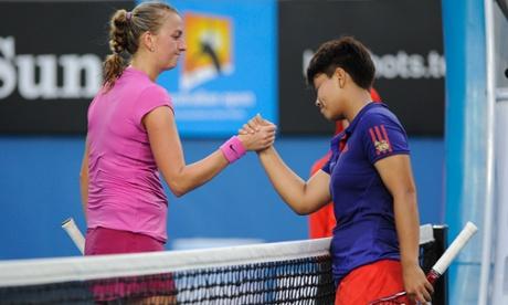 Luksika Kumkhum of Thailand shakes hands with Petra Kvitova.
