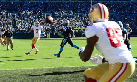 San Francisco 49ers quarterback Colin Kaepernick throws a touchdown to tight end Vernon Davis against the Carolina Panthers