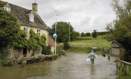 Wading through floods in Swinbrook, Oxfordshire