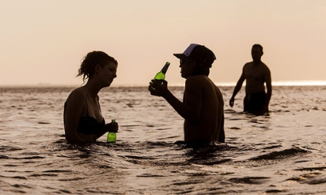 People cool off at Brighton Beach as temperatures reach over 40 degrees Celsius in Melbourne, Australia.