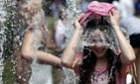 A tennis fan cools off at the Australian Open tennis tournament in Melbourne.