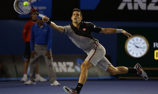 Novak Djokovic reaches for a shot against Denis Istomin.