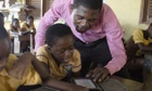 Pupils at Suhum primary school in Ghana read their e-readers