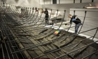 British Museum curators work on reconstructing a Viking warship for the upcoming exhibition