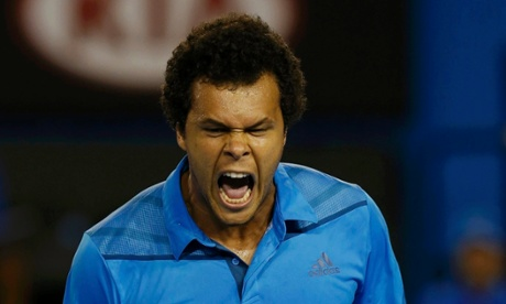Jo-Wilfried Tsonga of France reacts during his men's singles match against Roger Federer of Switzerland at the Australian Open 2014