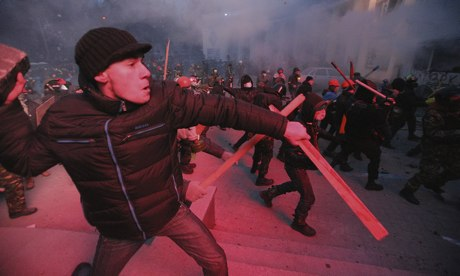 Protesters clash with police in Kiev, Ukraine, on Sunday. Photograph: Kommersant via Getty Images
