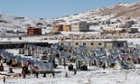 Syrian refugees walk outside their tents at a refugee camp in the eastern Lebanese border town of Arsal.