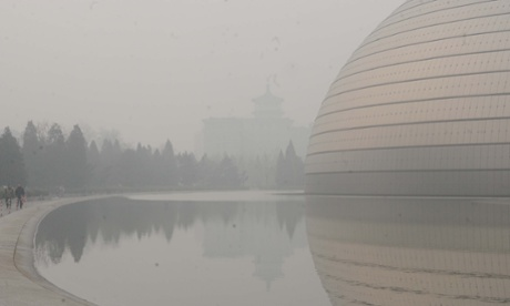 The National Grand Theatre, one of Beijing's landmarks, is blanketed in heavy smog in January 2014.