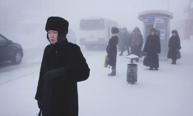 A Yakutian woman in the city centre. Steam from factories, cars and people creates a thick fog in winter which lingers through the coldest weeks. Yakutsk
