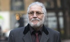 Dave Lee Travis arrives at court to face 13 charges of indecent assault and one of sexual assault