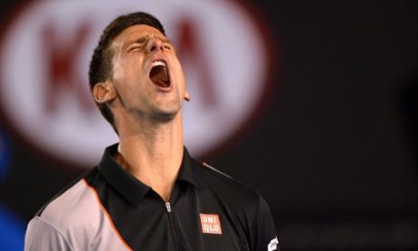 Serbia's Novak Djokovic shouts during his men's singles match against Switzerland's Stanislas Wawrinka on day nine at the 2014 Australian Open