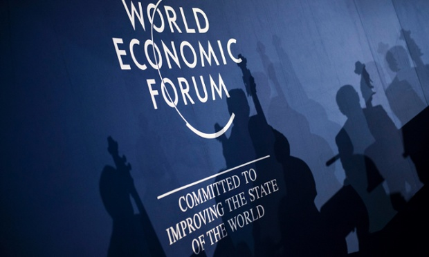 Musicians are silhouetted before the Crystal Award ceremony on the eve of the opening of the 44th Annual Meeting of the World Economic Forum (WEF), in Davos, Switzerland, 21 January 2014. The overarching theme of the meeting, which will take place from 22 to 25 January, is 'The Reshaping of the World: Consequences for Society, Politics and Business'.