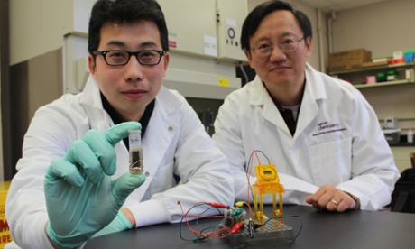 scientist holding new sugar battery