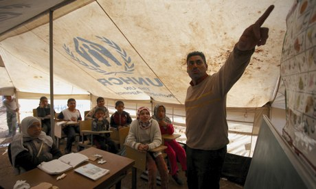 Syrian refugee children learn inside a makeshift tent class