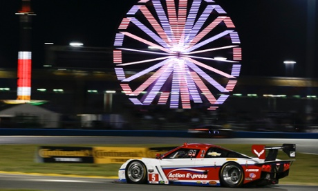 The Action Express Racing Corvette DP heads through the horseshoe turn during night practice for the IMSA Series Rolex 24 hour auto race at Daytona International Speedway in Daytona Beach, Florida, Thursday, January 23, 2014