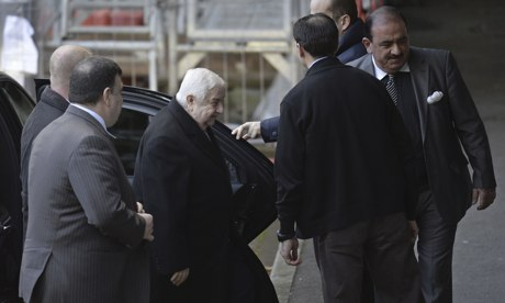 Syria's foreign minister Walid Muallem arrives at the UN in Geneva to meet mediator Lakhdar Brahimi