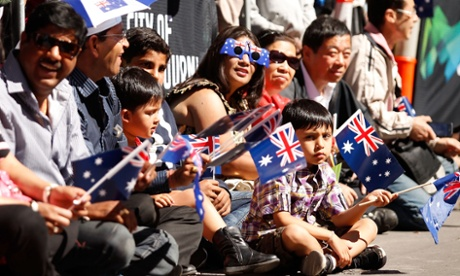 It's Australia Day, and a boy in prime position for the parade in Melbourne looks pretty damn excited about it.