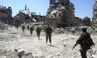 Lakhdar Brahimi: women and children can leave beseiged city of Homs