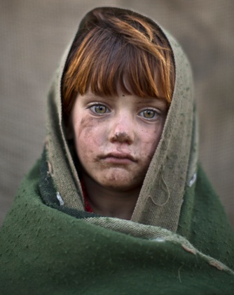 laiba Hazrat, six, a refugee from Afghanistan living in slum in Islamabad