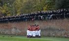 The Oppidans team huddle during the Eton Wall Game at Eton college in Eton