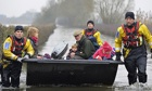 Boat carries residents on the Somerset Levels
