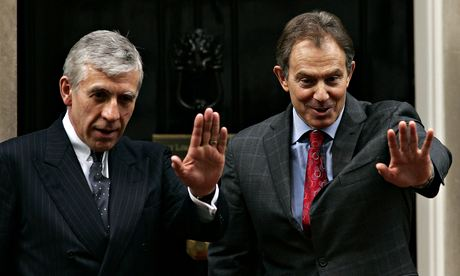 Britain's Prime Minister Blair and Foreign Secretary Straw wave in Downing Street