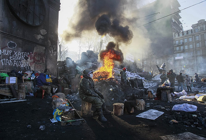 20 Photos: Anti-government protesters near a fire next to Independence Square in Kiev
