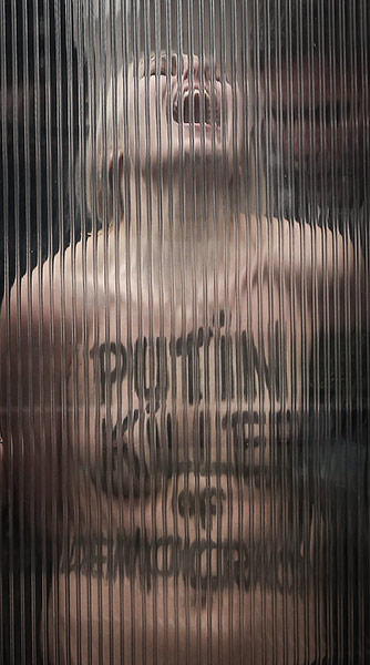 20 Photos: Femen Protest ahead of Putin visit in Brussels