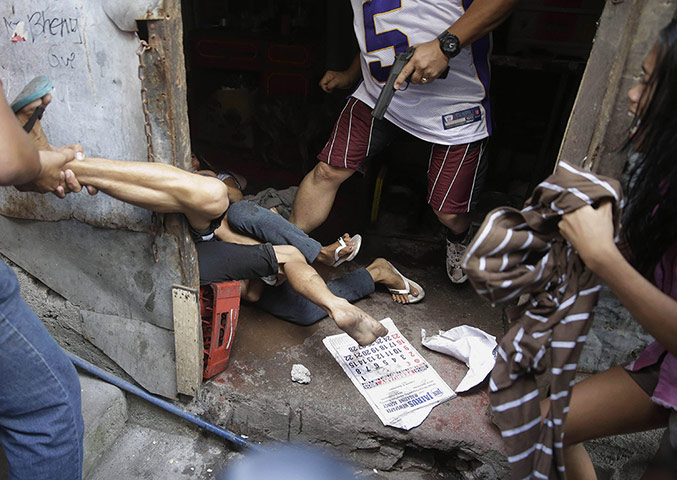 20 Photos: Police arrest a resident during the demolition of their shanties at Quezon