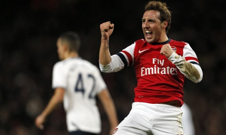 Arsenal's Santi Cazorla celebrates scoring the opening goal of the FA Cup third-round tie against Tottenham Hotspur.