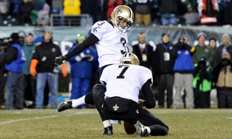 Shayne Graham of the New Orleans Saints kicks a 32 yard game winning field goal to defeat the Philadelphia Eagles in their NFC Wild Card Playoff game at Lincoln Financial Field on January 4, 2014