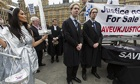 Lawyers protest against the legal aid cuts outside parliament earlier this year