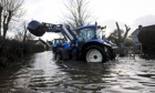 A tractor ventures out from a farm near the village of Muchelney