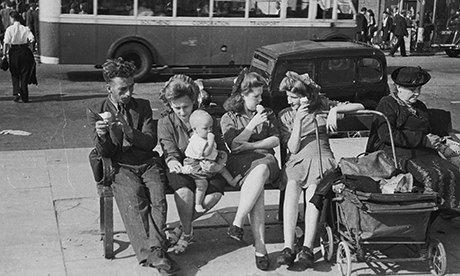 Holidaymakers eating ice-cream on a bench in Southend, first summer holiday since the end of WW2